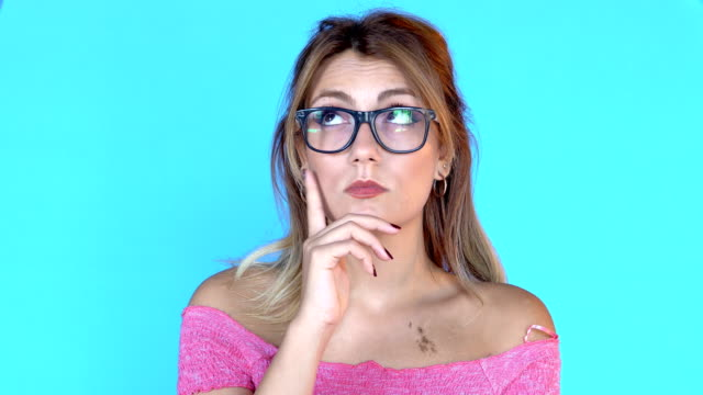 4k young pretty girl thinking about something - contemplazione video stock e b–roll
