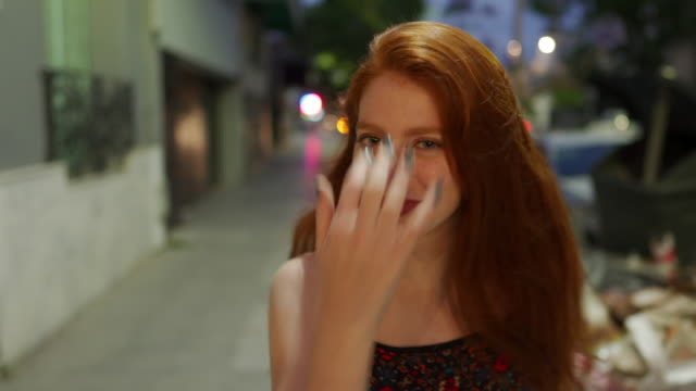 young pretty lady with orange hair walking in the city - freckle stock videos & royalty-free footage