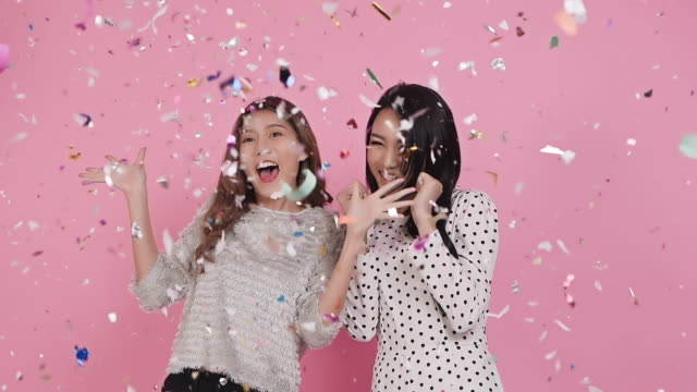 young pretty women enjoy and happy with paper shoot - colore isolato video stock e b–roll