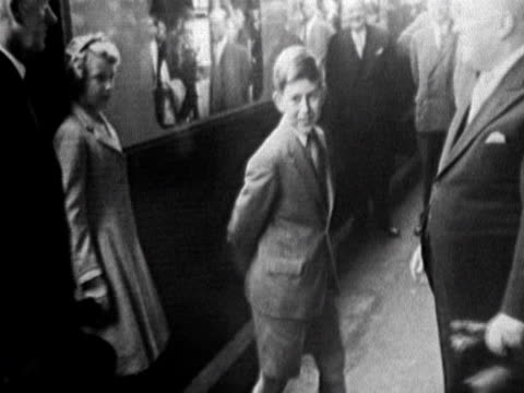 young prince charles and princess anne arrive in wales - principe persona nobile video stock e b–roll
