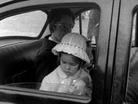 a young princess caroline and prince albert sit in the back of a car at london airport 1961 - monaco stock-videos und b-roll-filmmaterial
