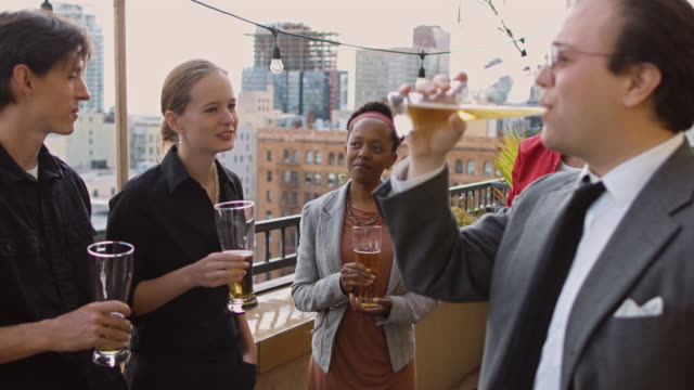 Young Professionals Drinking on Balcony