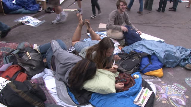 young protesters camp out in zuccotti park during the occupy wall street movement in lower manhattan. - occupy protests stock videos & royalty-free footage