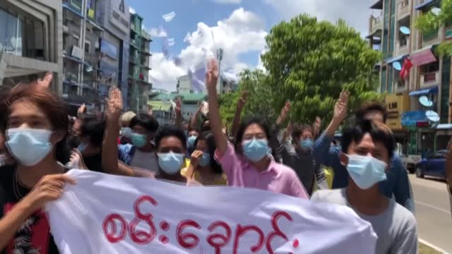 """young protesters in myanmar calling themselves """"gen-z"""" take to the streets in yangon's northern mayangone township, marching and holding up anti-coup... - generation z stock videos & royalty-free footage"""