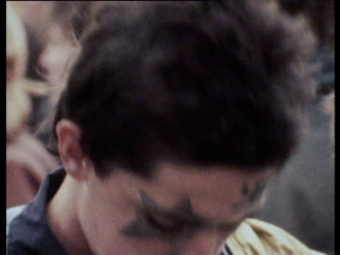 vidéos et rushes de young punk boy with painted black star over his eye and swastika on his forehead punk rock festival chelmsford; 17 sep 77 - punk