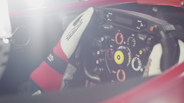 young racer operating steering wheel in racecar - racing car stock videos & royalty-free footage
