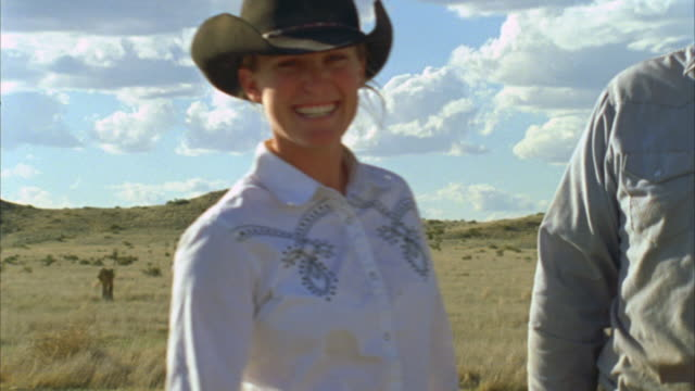 cu young ranching couple on their ranch / marfa, texas, usa  - cowboyhut stock-videos und b-roll-filmmaterial