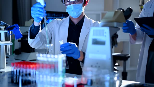 young researchers working in a scientific laboratory - tokyo japan stock videos & royalty-free footage