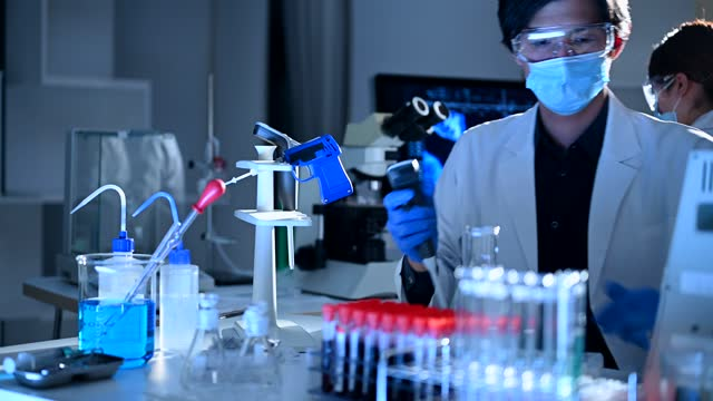 young researchers working in a scientific laboratory - medical test stock videos & royalty-free footage