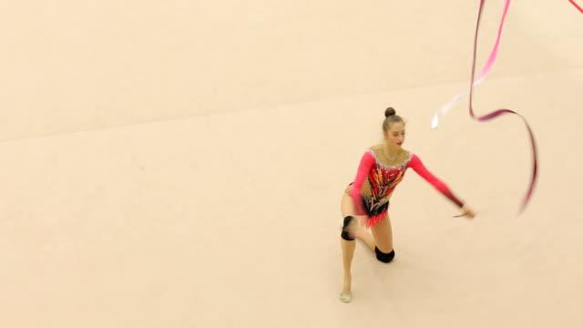 young rhythmic gymnastics athlete performing - rhythmic gymnastics stock videos & royalty-free footage