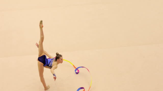 young rhythmic gymnastics athlete performing - pirouette stock videos and b-roll footage