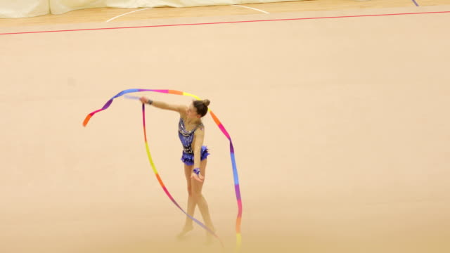 young rhythmic gymnastics athlete practicing with ribbon - persona di sesso femminile video stock e b–roll