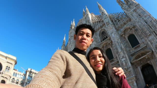 young romantic couple travel together at milan cathedral - 1965 stock videos & royalty-free footage