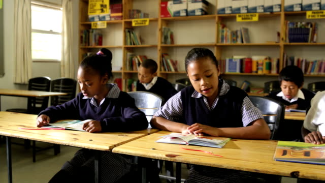 Young school children reading