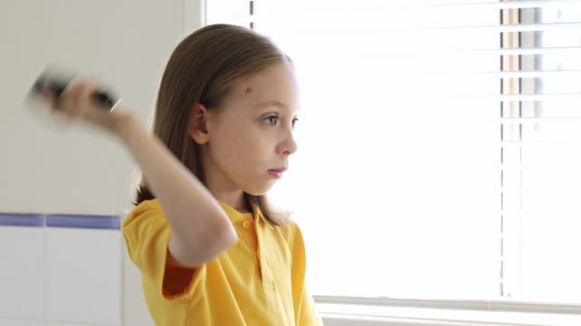 young school girl brushing hair - brushing hair stock videos & royalty-free footage