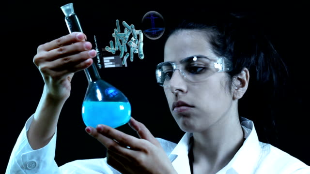 young scientist in the laboratory. - replication bubble stock videos and b-roll footage