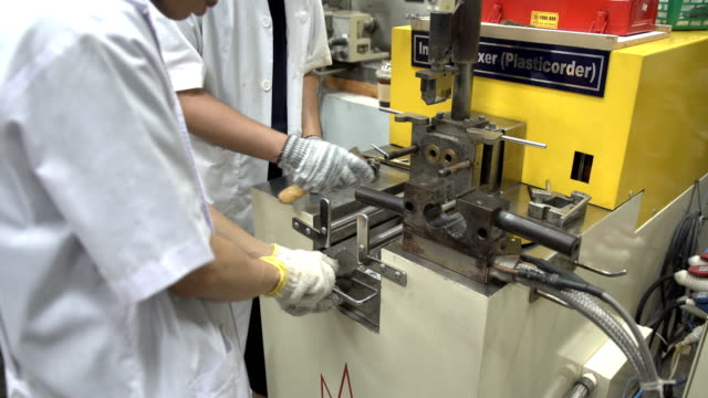 young scientist try to clean chamber part in brabender or internal mixer