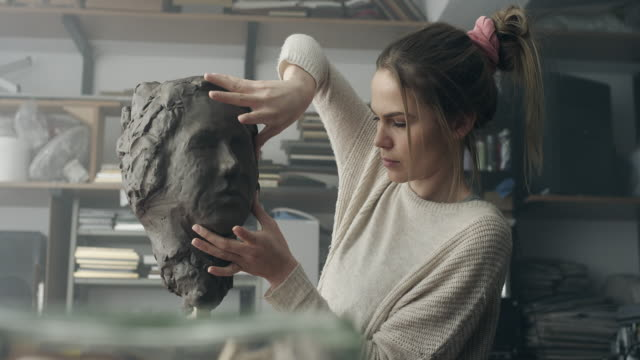 young sculptor creates a clay sculpture - sculpture stock videos & royalty-free footage