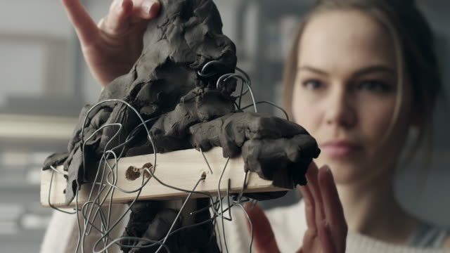 young sculptor creates a clay sculpture - sculpture stock videos and b-roll footage