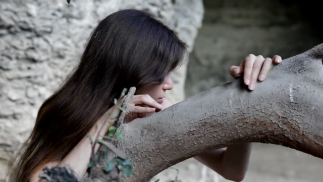 young seductive girl near tree trunk - purity stock videos & royalty-free footage