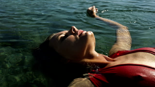 young serene woman floating on sea - zero gravity stock videos & royalty-free footage