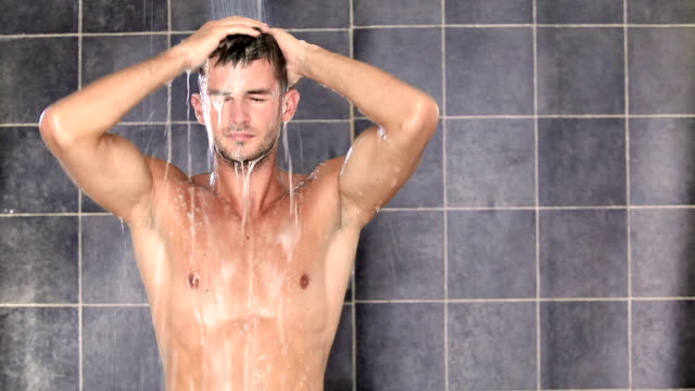 young sexy man having a shower - shampoo stock videos & royalty-free footage