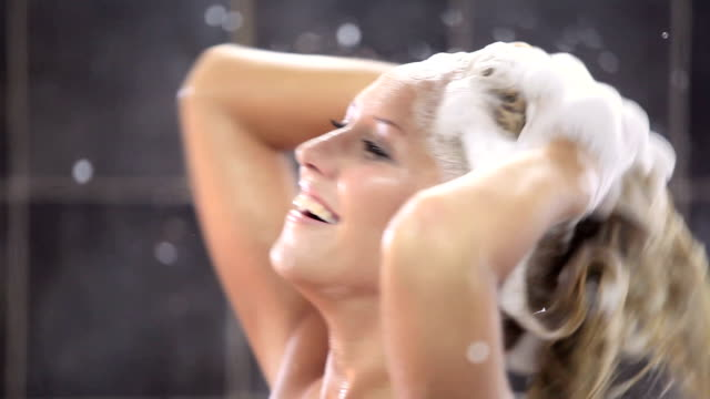 young sexy woman having a shower - washing hair stock videos & royalty-free footage