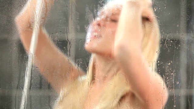 young sexy woman having a shower - shirtless stock videos and b-roll footage
