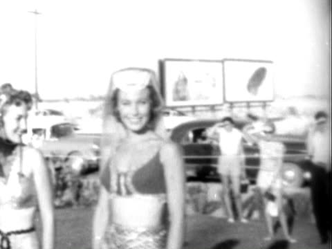 young showgirls dressed in revealing ancient arabian costumes, posing for camera at opening ceremony of the dunes hotel & casino / white male... - frank sinatra stock videos & royalty-free footage