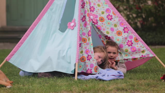 young siblings play in children's tent, medium shot - tent stock videos & royalty-free footage