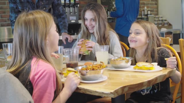 young sisters laughing at a restaurant - fast food restaurant stock videos & royalty-free footage