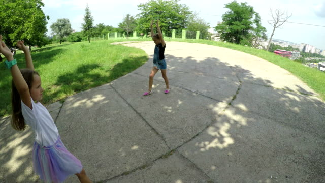 young sisters playing in park - shade stock videos & royalty-free footage