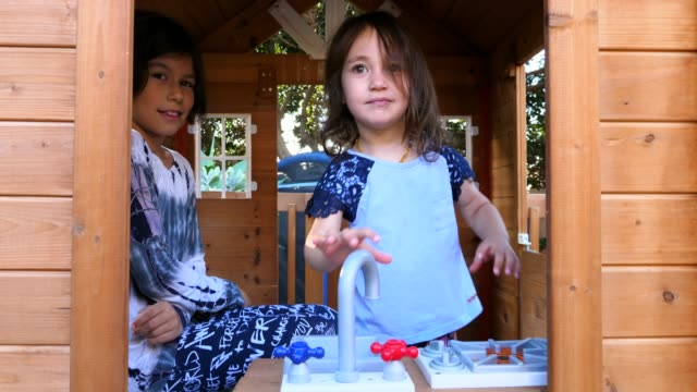 ms young sisters playing in play house in backyard - playhouse stock videos and b-roll footage