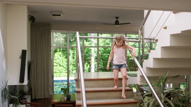 young sisters running up and down stairs in modern family home - steps and staircases stock videos & royalty-free footage