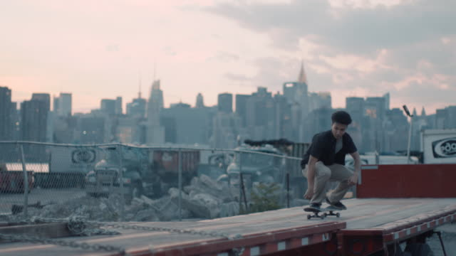 a young skateboarder crashes in slow motion - nyc - moving down video stock e b–roll