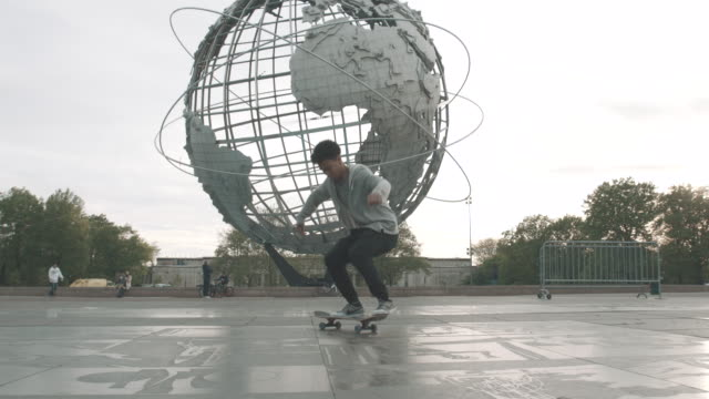 A young skateboarder performs a trick at a Queens, NYC skatepark - slow motion - 4k