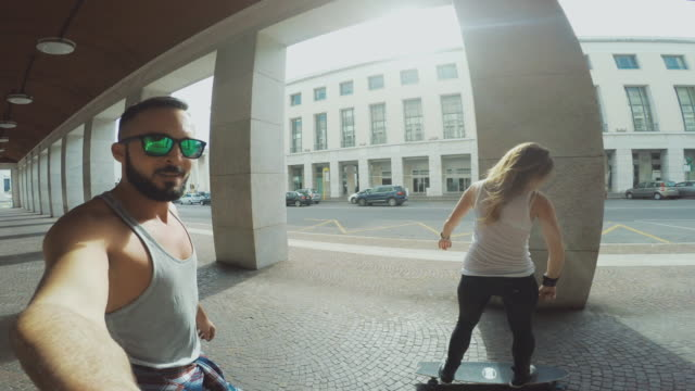Young skater take a selfie video while riding