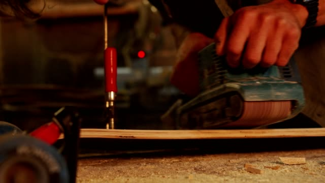 a young skilled carpenter using a sander - moulding a shape stock videos & royalty-free footage