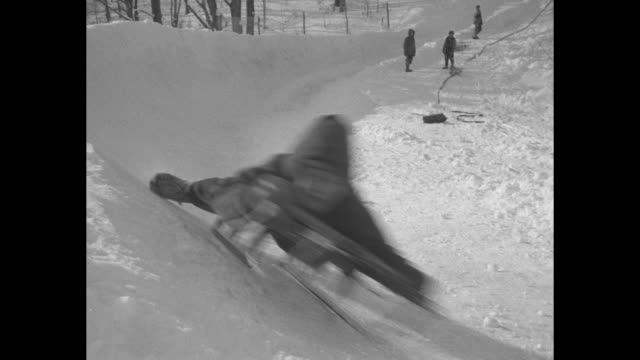 vs young sledder takes off in bobsled speeds down course at the pee wee bobsled championship at the olympic run at lake placid ny / vs boys hit... - bobsleighing stock videos & royalty-free footage