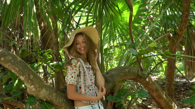 young smiling woman in a forest - seductive women stock videos & royalty-free footage
