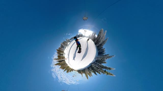young snowboarder enjoying his ride in a ski resort - fish eye lens stock videos & royalty-free footage