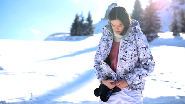 Young Snowboarder Girl Preparing To Slide Down Hill