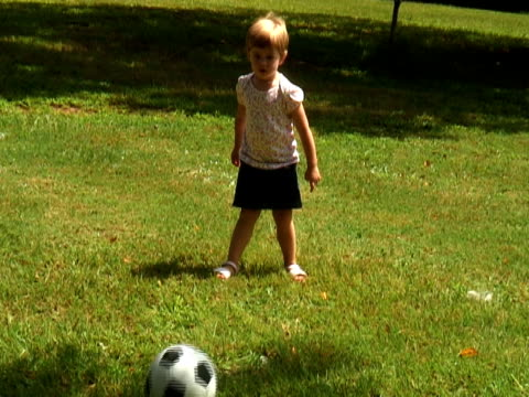 "young soccer star. shot handheld ""news"" style - kicking stock videos & royalty-free footage"