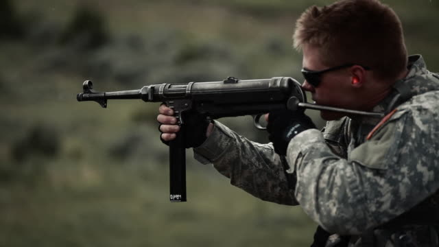 young soldier shooting an mp40 - mp stock-videos und b-roll-filmmaterial