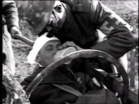 young soldier with bloody head bandage is helped by comrades - medical dressing stock videos & royalty-free footage