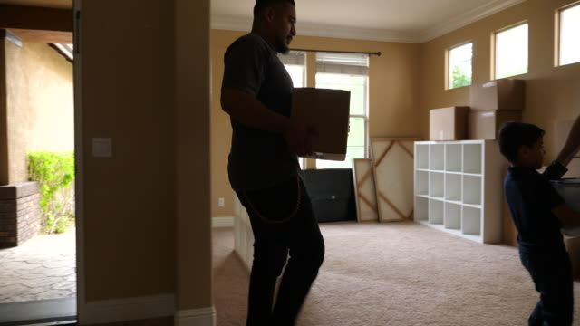 ms young son helping father and grandfather move boxes into new home - latin american and hispanic ethnicity stock videos & royalty-free footage