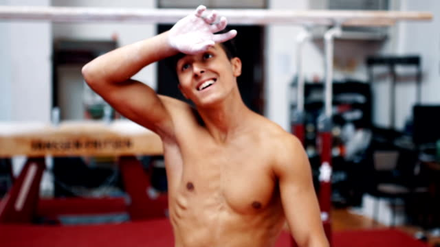 young sports man entering gymnastic hall - concentration stock videos & royalty-free footage