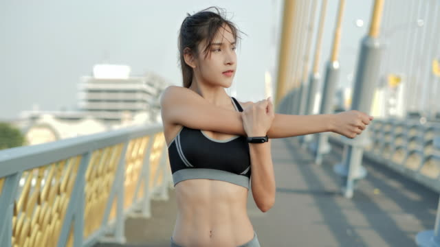 young sports woman stretching and preparing to running in the city.woman with beautiful body after diet.lifestyle,success,power,healthy,women in sportsport prep - abdominal muscle stock videos & royalty-free footage