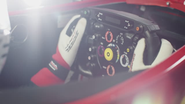 Young sportsperson holding steering wheel in car