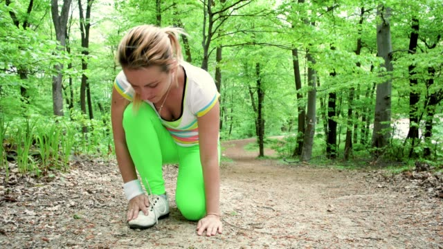 Young sportswoman injures her ankle while running in the park.